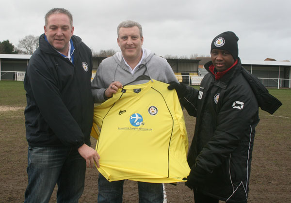 Rob Mitchell receives EFS logo'd shirt from Cove FC