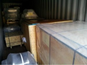 container being loaded for Angola